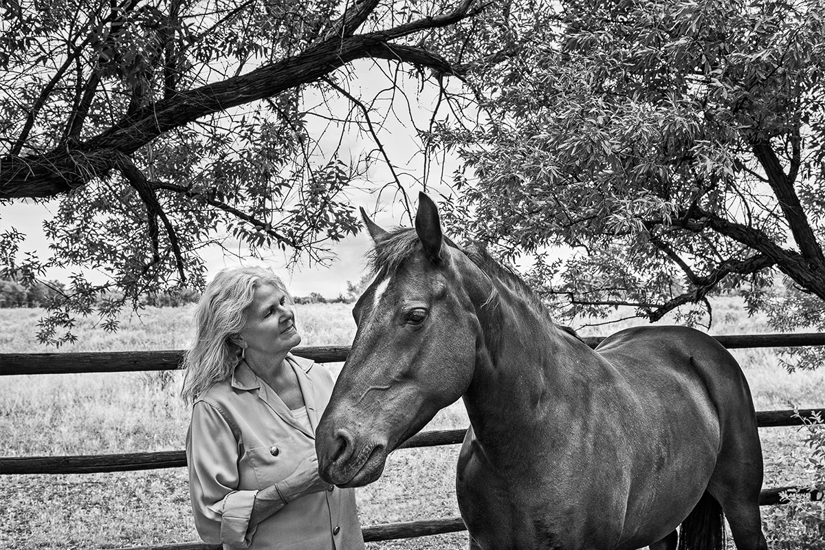 Horses black and white portrait of woman and horse under tree photographed by Cate Goedert Santa Fe pet photographer