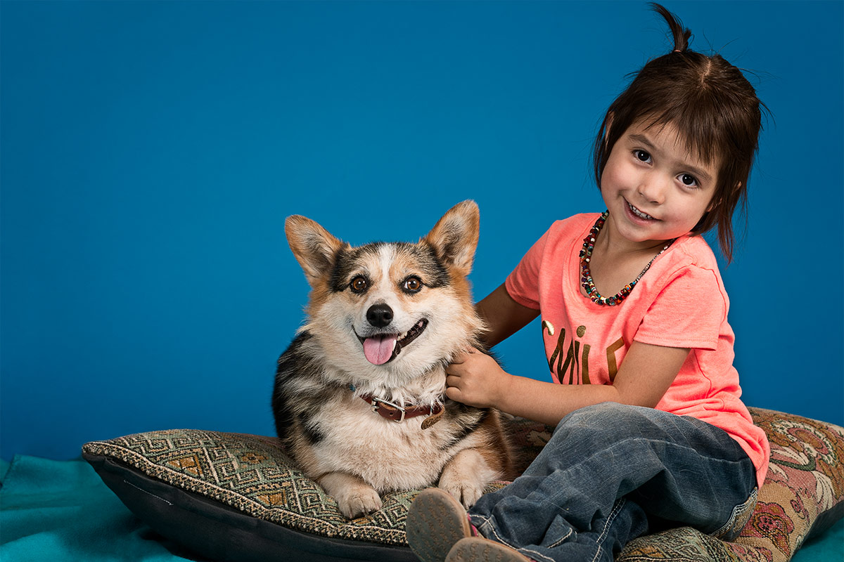 companions portrait of little girl and her corgi dog by Cate Goedert Santa Fe New Mexico pet photographer