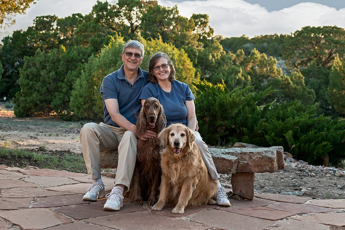 companions family portrait with Irish Setter and Golden Retriever by Cate Goedert Santa Fe New Mexico pet photographer