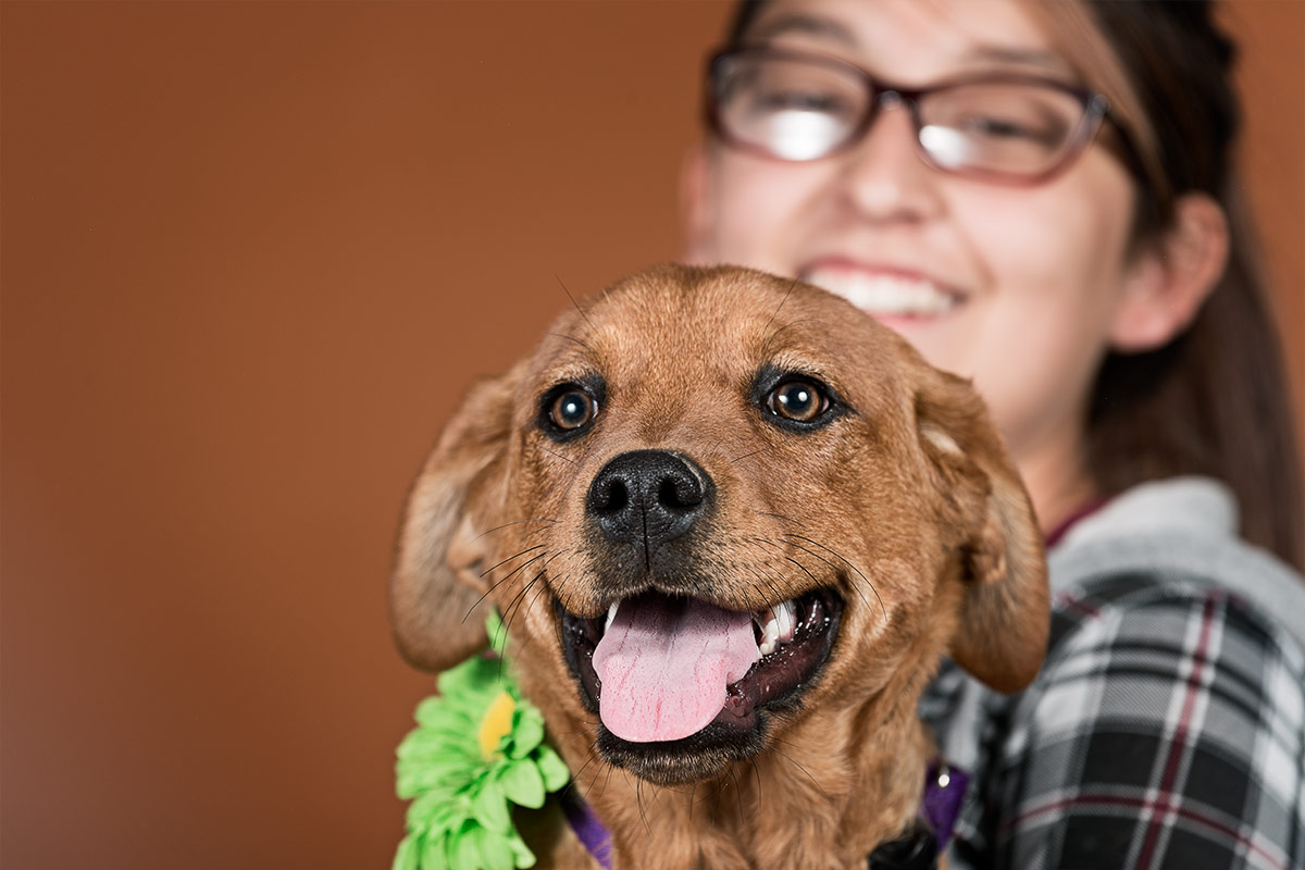companions portrait of woman holding grinning puppy by Cate Goedert Santa Fe New Mexico pet photographer